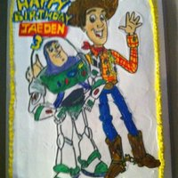Toy Story Cake This was one of my first cakes I painted Buzz and Woody on rice paper with piping gel on whipping cream.