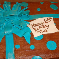 65Th Birthday Cake Chocolate 65th Birthday Cake with Chocolate Butter Cream and barvain cream filling the bow and poka dots are done in Fondant.