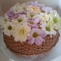 Flower Basket. Piped basket weave on the base of the cake with edible flowers over the top
