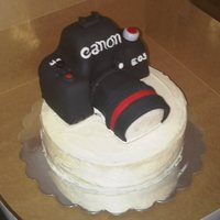 Camera Cake My first time doing a a camera cake. Both camera and bottom tier are red velvet with cream cheese frosting. Camera is covered with fondant...