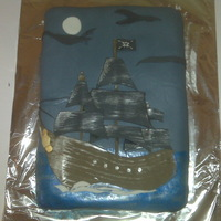 Pirate Ship Cake My nephew asked for a pirate ship cake: So I cut fondant in the shapes of the sails and hull of the Black Pearl and painted the blue...