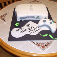 Xbox 360 Cake Fondant covered yellow cake with buttercream frosting. XBox Controller made with RKT and covered with Fondant.