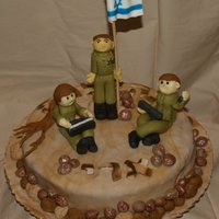Army Induction Cake This was for a young man named Ari who is being inducted into the army. The figurines are all hand sculpted out of fondant, the stones are...