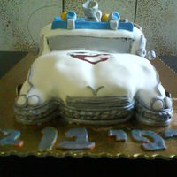 Ecto 1 Ghostbusters Cake All edible except for the wire. Uses Satin Ice MMF. Silver petal dust and gel colors.