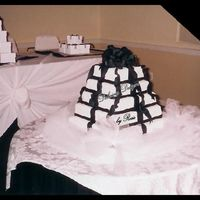 Tower Of Gifts This was for a formal graduation party...Black & White was the color scheme...The guest of honor wanted the cake to look like the...