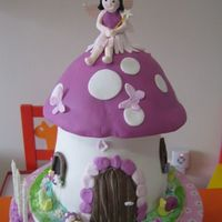 Fairy Princess For Wendy Made this one for my niece, choc cake for the toadstool and vanilla cupcake for the cupcake tower. Made the stand using cake board.