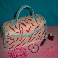 Animal Print Purse 6Th Birthday Cake animal print fondant covered chocolate cake! nailpolish and lipstick are made out of fondant. added childrens play jewelry to complete!