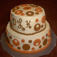 Fall Wedding Cake 2-tier Buttercream wedding cake with burnt orange/brown circles.I was called 2 days before wedding and asked to make this cake.