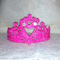 Royal Icing Tiara In Pink Royal icing tiara, airbrushed pink. Jewels not edible. Sorry the picture is a little blown out...I was having difficulties. I'm glad I...