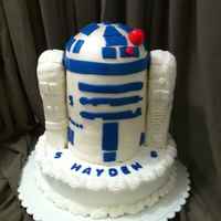 "R2D2 stacked cakes atop a larger base cake, with rice cereal treat ""arms"". An incredibly easy cake, I discovered. I have made three..."