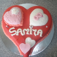 Hartshaped Birthday Cake   hart shaped cake for a 8 year old girl. filled with pink biscuit, pint buttercream, strawberry jam and strawberry cream