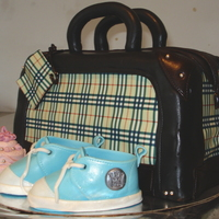 Burberry Bag   filled with chocolate bicuit an 3 layers of dark chocolate truffle creamcovered with chocolate fondant, shoes made of coloured fondant