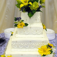 Spring Wedding Cake 4 tier square wedding cake with fresh florals and edible white fondant pearls!