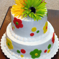 Flower Power Girls birthday party cake.....2 tier, white frosted cake with cutout fondant flowers and dots. Accented with neon orange, yellow, &...