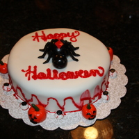 Halloween Cake I made the black widow spider out of fondant and the pumpkins and eyeballs as well. I watered down and colored piping gel to make it look...