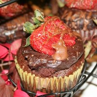 Chocolate Civered Strawberry Cupcake filled with strawberry buttercream