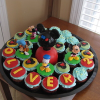 Mickey Mouse Clubhouse Made these for my son's 2nd bday. Double chocolate cupcakes with vanilla buttercream. Red and black Duff fondant. MMF for the others...