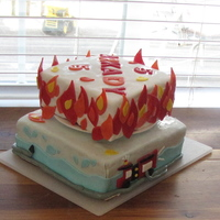 Fire!! 5th bday cake. Strawberry pound cake with milk chocolate ganache filling.