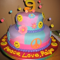 Peace And Love Tye Dye Cake  This was a cake made for a young girl who wanted all peace signs and flowers and smileys! It was custom made to fit her colors of teal,...