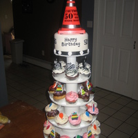 50Th Birthday Cupcake Tower With Top Tier Fondant Cake This was a cake made for a 50th birthday party - so cute, used some GOTCHA things as a joke - the cupcake were all decorated accordingly to...