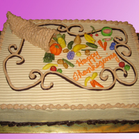 Thanksgiving Cornucopia Sheet Cake  This was a cake ordered by a client who wanted a cool custom sheet cake. The cornucopia itself was made from gumpaste and later decorated...