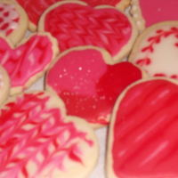 Valentine Cookies Fun heart shaped VDay cookies using No Fail Sugar Cookie recipe. Huge hit with everyone. Had a fun day decorating these with my daughter.