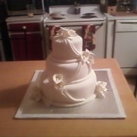 Calla Lily Wedding Cake First wedding cake and first time making gumpaste flowers and drapes. WASC cake with buttercream frosting and MMF
