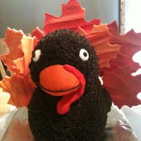 Gobble It Up!! I made this turkey cake using the Rubber Ducky mold. The feathers are Wilton Candy Melts. This is my third cake I've ever made,...