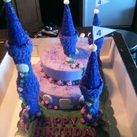 Princess Castle Cake....inspired By Tangled This is my first princess castle cake. It was inspired by the Disney movie Tangled. I basically just used the color schemes as I am not...