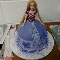 Rapunzel Princess Doll Cake I made this as a surprise for the birthday girl. I had a really hard time getting the purple for the cake to match the purple on Rapunzel&#...