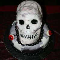My Third Cake (Skull ) I made this cake for my co-workers teenagers halloween party and they loved it. Their guests didnt even realize it was a cake until they...