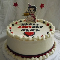 Betty Boop!   Just a simple buttercream cake, I used the colored sixlets on top. Betty is a gumpaste plaque.