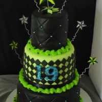 Nautical Star Cake   Lime green and black fondant with blue, silver and lime green hand painted nautical stars.