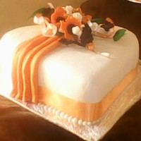 Orange And Brown Wedding Cake Iced and decorated with plastic icing