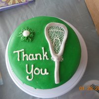 Thank You To A Lacrosse Coach Green is MMF and the lacrosse stick is buttercream fondant.