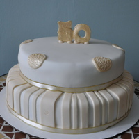 50Th Anniversary  Vanilla cake covered in buttercream and then covered in fondant. I didn't achieve the gold colour I had hoped for in the topper/...