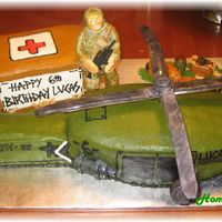 Army Helicopter Bday Cake this was for my son...he wanted a helicopter so bad...I had never done one before....the propellers broke of course! fondant army man, box...