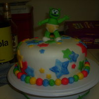 First Fondant Cake  my first time working with fondant, and doing figurines. i really learnt alot (meaning lots of trial and error haha) my son loved the gummi...