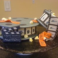 Lights, Camera, Auction! I made this cake to donate to a neighborhood community center dessert auction. Their theme was Lights, Camera, Auction! Great fun playing...