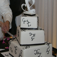 Black And White Offset Square Wedding Cake White fondant with black royal icing swirls. Ribbon is satin