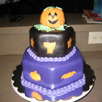 Happy Halloween I am new to cake decorating and thought I'd try fondant cut out's. All of this cake is edible. Enjoy!!