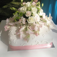 Ochids And Scrolls Single layer Wedding cake. The fresh flower arrangment was also done by me.