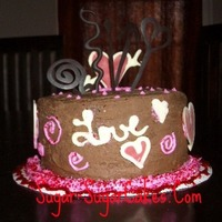 Love And Chocolate Ganache frosting and chocolate decorations.