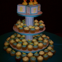Ducky Baby Shower Blue Cupcakes are Guava with Guava cream cheese icing; Yellow cupcakes are white chocolate with a white chocolate buttercream/ganache....