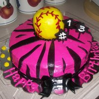 Hot Pink Girls Softball Cake Hot pink Icing is buttercream. Stripes, bow, and stars are MMF. The softball is made out of rice krispies and covered in fondant. She...
