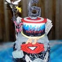Avenger's Superhero Cake For a big superhero fan, my nephew. The bottom tier is for Thor, hand-painted lightning strikes with white edible paint, free-hand fondant...