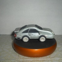 Gumpaste Porsche This was my first attempt at making a car out of gumpaste...I guess it turned out ok. A friend had asked me to make one for her husband&#...
