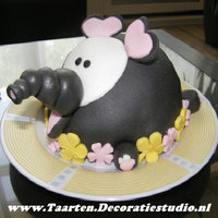 Elephant Cake Decorated with flowerpaste, filled with cake and butter cream. Also made a little one.
