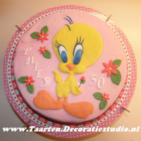 Tweety Birthday Cake Decorated with flowerpaste, filled with butter cream, whipped creme and biscuit.