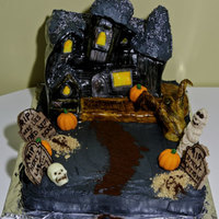 Halloween Cake Here is a 100% edible Halloween cake we created. haunted house was designed to resemble an old decrepent house, using cereal treats and...